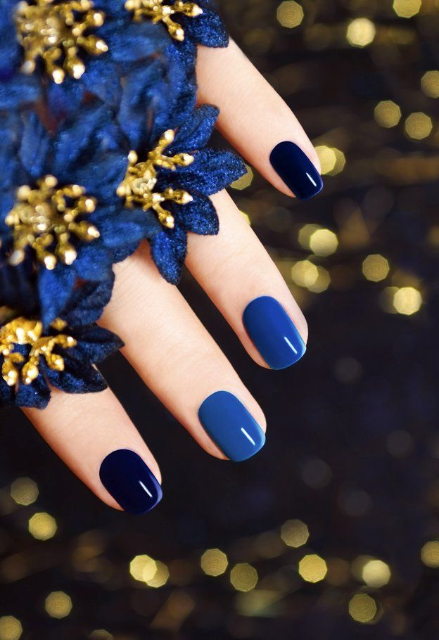 Hand with blue nail polish