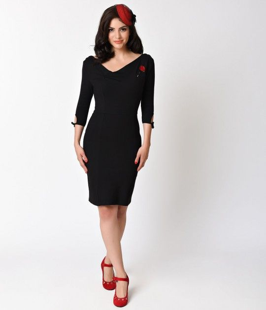 Top notch and tremendously titillating! The Carmen Dress is a sexy black fitted frock that deliciously hugs your feminine form in a durable soft knit, crafted in a ravishing stretch composition. A sultry asymmetrical neckline, shoulder pleats, princess se