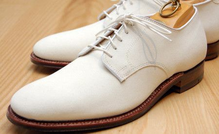 White bucks are Oxfords made of white buckskin, a rough leather than in reality is not exactly white.
