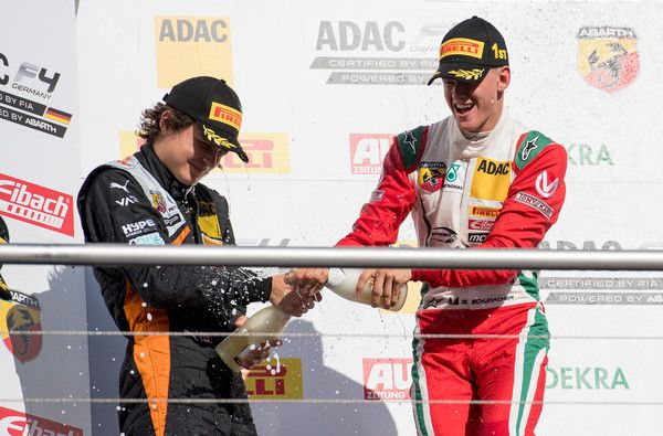 Mick Schumacher Photos Photos - The first placed Mick Schumacher (R) celebrates with the second placed Kami Laliberte after the third race during ADAC Formula 4 at Hockenheimring on October 2, 2016 in Hockenheim, Germany. - ADAC Formula 4 Hockenheim - Day 2
