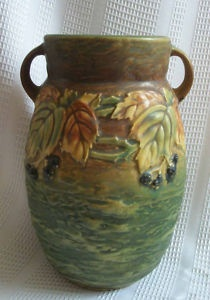 Blackberry Vase. The Roseville Pottery Company was an American pottery manufacturer in the 19th and 20th centuries. Though originally simple household pieces, the design of the pottery was popular with the American Arts and Crafts movement and pieces are now sought after by collectors.