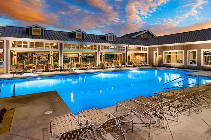 Trumark announces opening of community Kindred House at Wallis Ranch in Dublin, CA. Kindred House pool at twilight. Credit: Christopher Mayer Photography