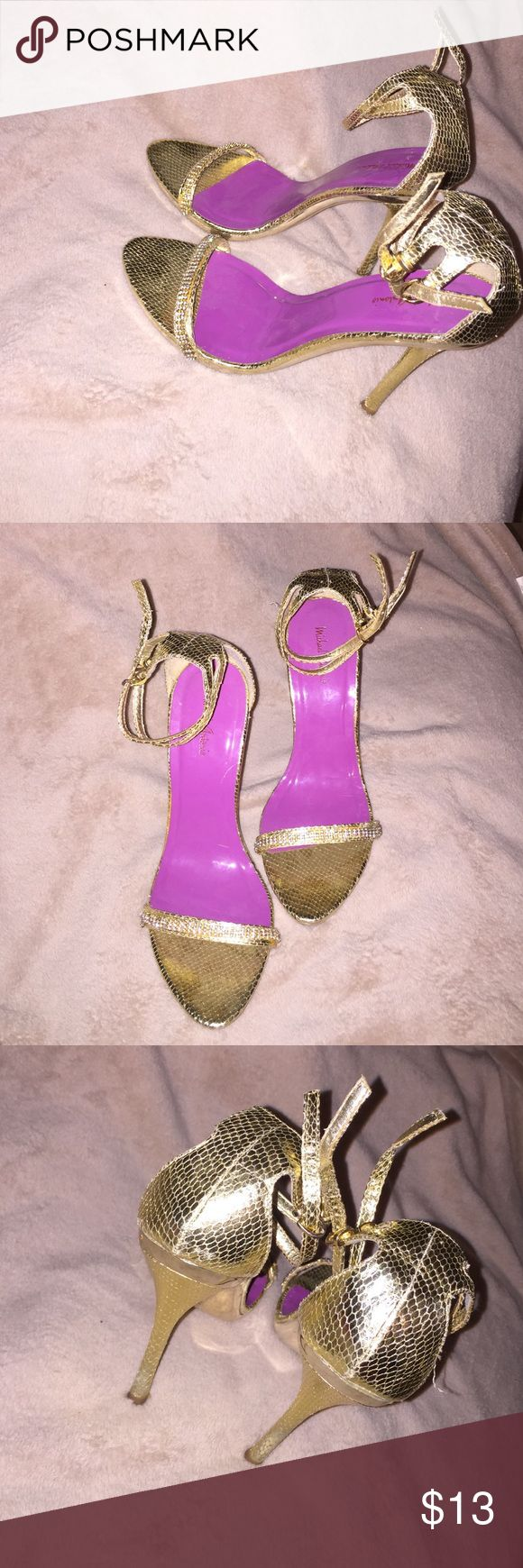 Gold Stiletto Heels Sexy gold stiletto heels. Has two gold straps that wrap around your ankles. Heel Height is 5 inches. Purple soles. Worn once. Shoes Heels