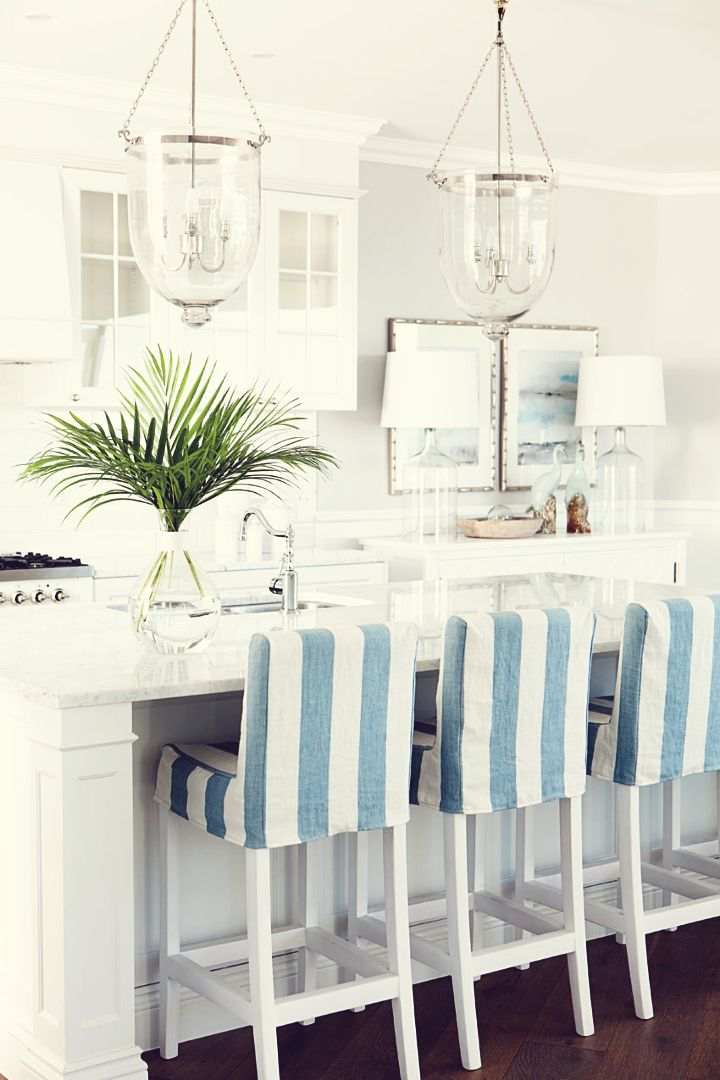 Nautical stripes and bright whites give your home a coastal feel. #HomeGoodsHappy