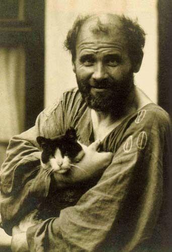 Gustav Klimt, Austrian Art Nouveau painter, with cat