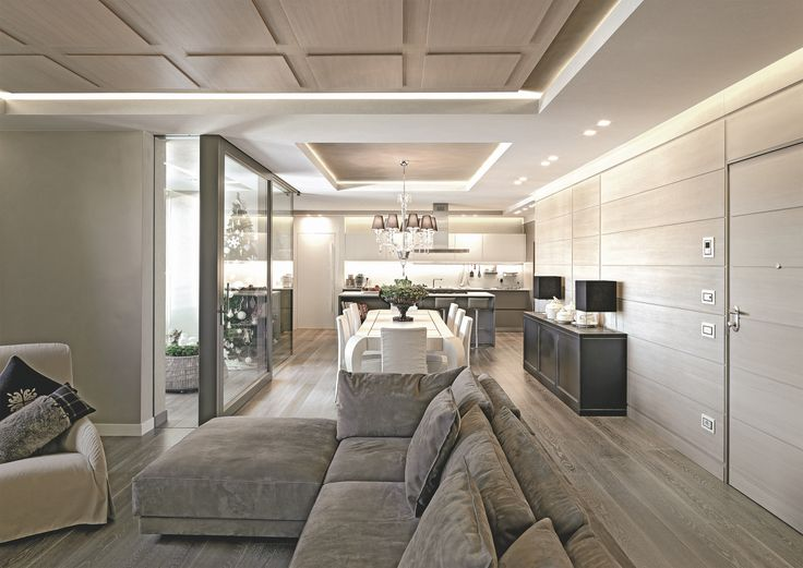A single, dynamic and articulated openspace enhanced by wood panelling.