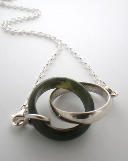Valentines Jewellery; made in New Zealand.  Interlinked rings, pounamu (New Zealand greenstone) and sterling silver necklace.