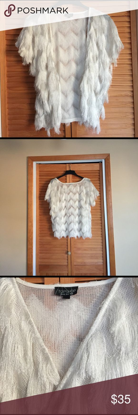 Topshop top Unique feather tassel cape, over an evening dress for a cool summer night; great dress down with Jean as well. It's a piece you'll wear again and again. Sold out Topshop piece. Size does matter since it's open front . It works for size 6-12 Topshop Tops