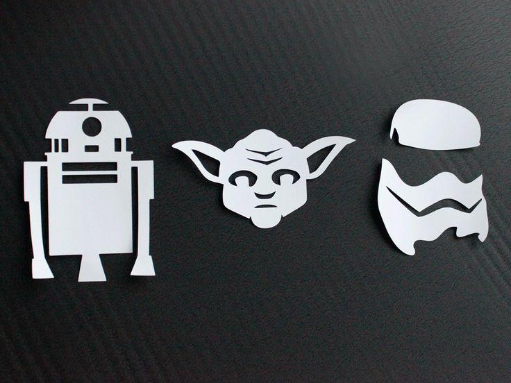 Hier liegen die frisch geplotteten Motive: R2D2, Yoda und Stormtrooper. {FreePrintables Plotterdateien}