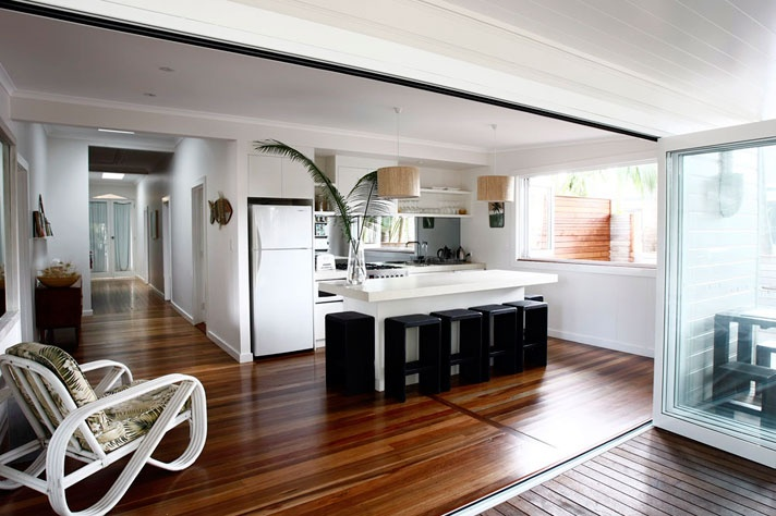 Atlantis Byron Bay coolness. Love the timber flooring and bifolds onto deck.