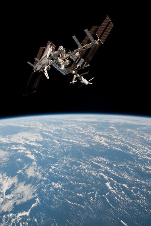 May 23, 2011 – Earth and the Space Shuttle Endeavour docked with the ISS, as seen from a Soyuz spacecraft.