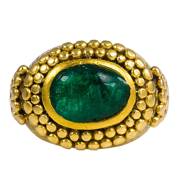 """RENE BOIVIN . An Art Deco gold and cabochon emerald """"Bague Egyptienne"""" ring in the ancient style with granulated decoration, in 18k. Inscribed and Dated: December 4, 1923-December 4, 1933."""