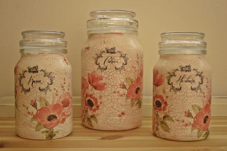 Old coffee jars decoupaged with napkins.