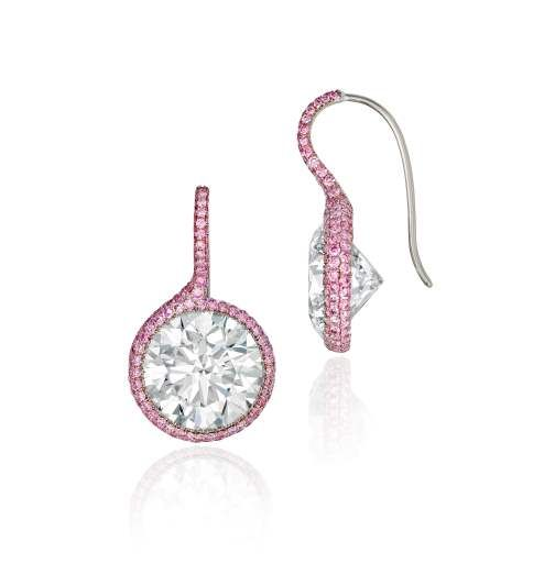 Sotheby's Diamonds -  Diamond Twist Earrings. There are many ways to life a diamond into the light, but few so effortless as this. Each centering a round brilliant-cut diamond, weighing a total of 20.16 carats, with additional pavé set pink diamonds. Mounted in blackened 18k white gold.