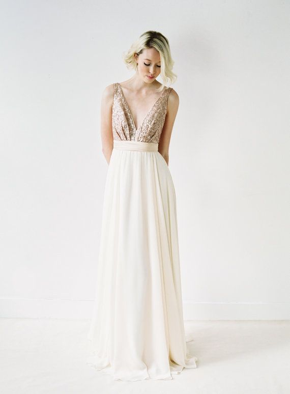 This gown features a plunging neckline, open sides, and a striking back. The skirt is made on the bias using almond chiffon, which flows effortlessly
