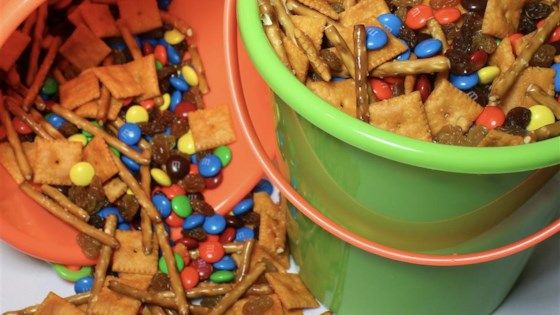 This snack mix combines candy coated chocolate pieces, pretzel sticks, Cheddar cheese crackers and raisins.