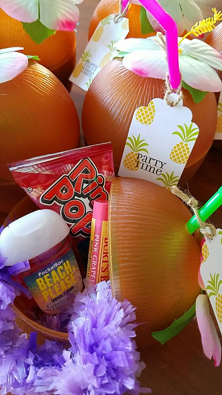 Beach themed bachelorette party favors. Leis, ring pops, lip balm in fruity flavors, bubbles and sanitizer in a cute coconut sipper.