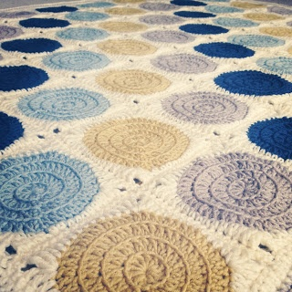 Another adorable version of a granny square blanket. With cool colors.