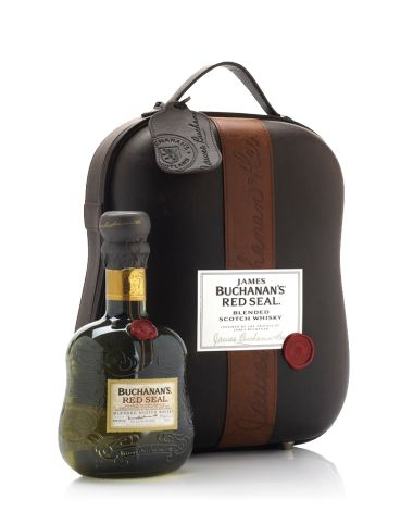 Buchanan's Red Seal 2012 Travel Trunk Limited edition travel inspired pack. A moulded PU leather case with a detailed, soft-finished forming that holds a bottle and 2 bespoke glasses. A booklet containing the history of the brand is held in the door within a recess and retaining grosgrain ribbon.