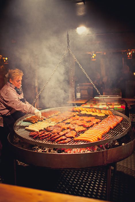 Sausage on a large swinging grill... Christmas market food is the best!
