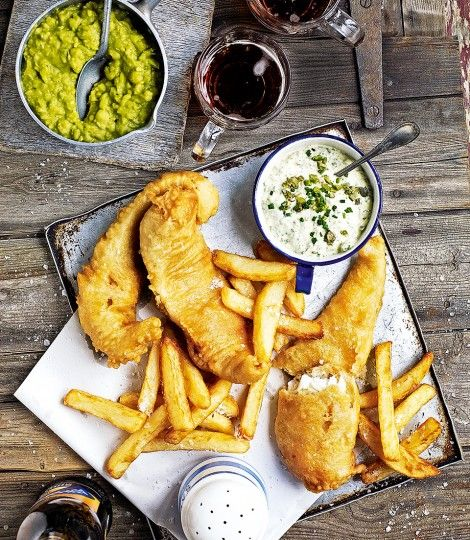 Debbie Major's ultimate British seaside treat is bought to the table with her brilliant fish and chips recipe served with mushy peas and tartare sauce.