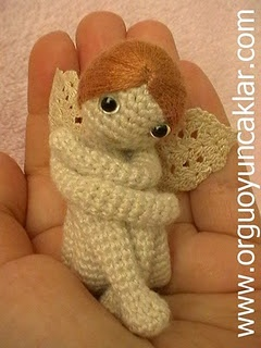 This angel or fairy pattern is available in her etsy shop so you can crochet it too