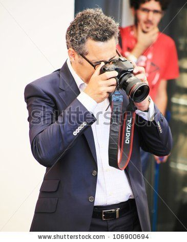 VENICE, ITALY - SEPTEMBER 04: John Turturro takes a pictures of photographers on the red carpet at 67th Venice Film Festival September 04, 2010 in Venice, Italy. - stock photo