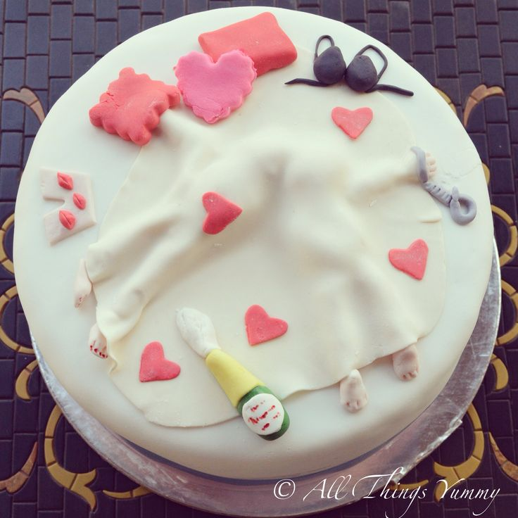 Bachelorette Cakes - A Chocolate Truffle Bachelorette Cake with White Fondant Hen's Night Inspired Decor | All Things Yummy #allthingsyummy #bachelorette #cakes #fondant