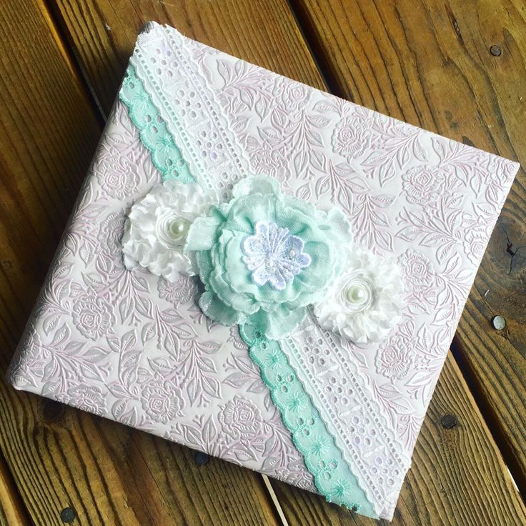 A personal favorite from my Etsy shop https://www.etsy.com/listing/448781822/handmade-wedding-album-pink-and-aqua