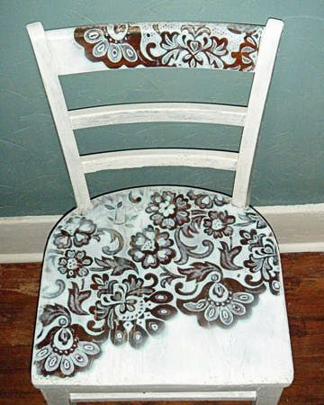 this was done with a piece of lace curtain that was taped to the chair and then spray painted. These chairs are a dime a dozen! Especially good if you cant afford a dining room table set!!