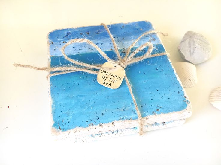 Ocean stone coaster, hand painted, set of 2 w/ charm, beach sea and sky natural stone coasters, coastal decor, tile coaster, gift idea, ocea by SweepOfSand on Etsy https://www.etsy.com/listing/561111567/ocean-stone-coaster-hand-painted-set-of