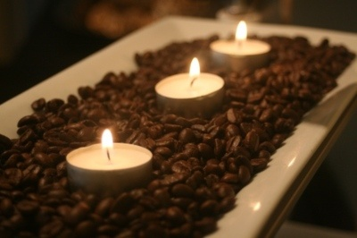 Fill a bowl or small serving platter with coffee beans and add tea lights - when you burn them your whole house will smell like freshly brewed coffee.