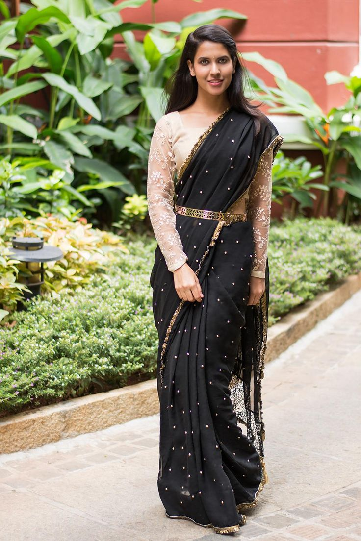 LBD is western, LBS(Long Black Saree) is Indian and fun, we might say! Night sky and stars like, this black georgette with stone work immediately lights up any room you walk in. Funk her up with a chunky belt or keep it simple with a beige netted blouse, she is a beauty and we cannot help but drool. #black #georgette #stonework #saree #India #blouse #houseofblouse