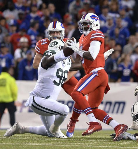 (AP Photo/Adrian Kraus). Buffalo Bills quarterback Tyrod Taylor (5) looks to pass under pressure from New York Jets defensive end Muhammad Wilkerson (96) during the first half of an NFL football game Thursday, Sept. 15, 2016, in Orchard Park, N.Y