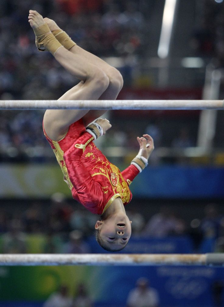 U.S. gymnast Nastia Liukin performs on the uneven bars during the womens' gymnastics individual all-around finals at the Beijing 2008 Olympics in Beijing, Friday, Aug. 15, 2008. Photo by aeliad