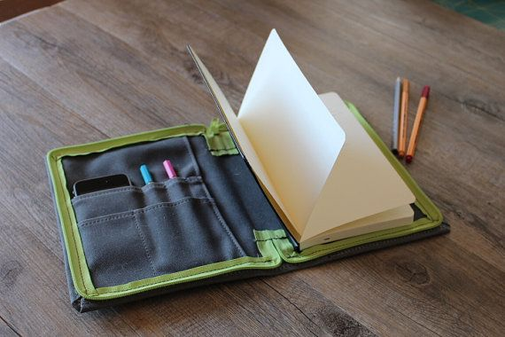 Waxed canvas cover journal This canvas organizer has space to put inside a sketchbook moleskine, pens, tickets, a phone and all that you
