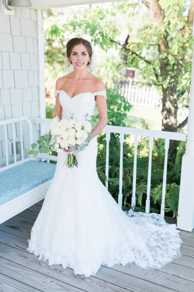 Beautiful blushing bride in a Jenna in White wedding dress // Wedding in Traverse City, Northern Michigan at Crooked Creek Ranch // Beth Joy Photography