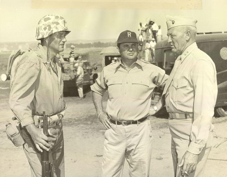 Major General Graves B. Erskine and John Wayne on Set of Sands of Iwo Jima, 1949  Major General Graves B. Erskine talks with John Wayne during the filming of Sands of Iwo Jima.   From the Graves B. Erskine Collection (COLL/3065) at the Marine Corps Archives and Special Collections   OFFICIAL USMC PHOTOGRAPH