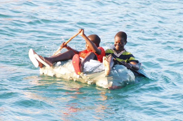 Boys aboard a makeshift raft in Dar Es Salaam