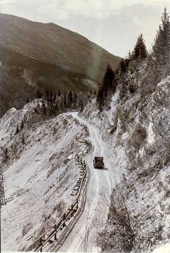 A car makes its way along the road, likely just outside of Golden on what is now the Trans-Canada Highway. #TCH50 #BCHwy1 #Golden #BC