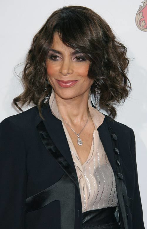 *Layered shoulder length hairstyle and curls:         -Loose messy curls are a big hit if you are going for curls on a Shoulder length hairstyle.  (paula abdul and jeff bratton)