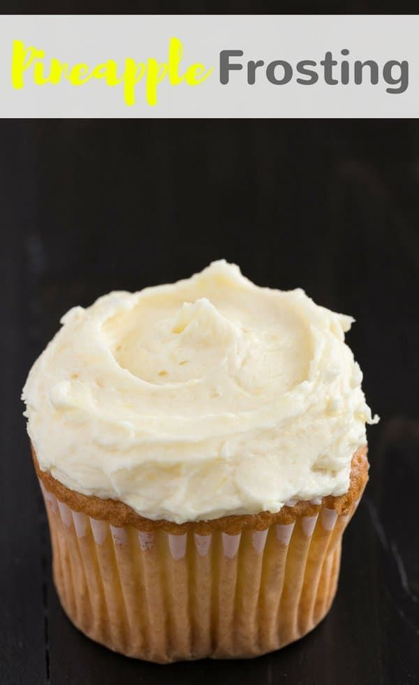 Thick and creamy Pineapple Frosting with tiny bits of pineapple speckled throughout will make all your cakes and cupcakes taste amazing! #pineapple #frosting #buttercream #dessert  via @introvertbaker