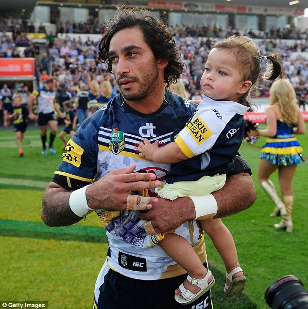 Johnathan Thurston walks on the field with his daughter Frankie at the start of the round seven NRL match between the North Queensland Cowboys and the New Zealand Warriors