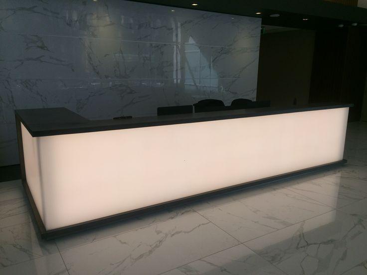 Concrete security desk with backlit led panels.