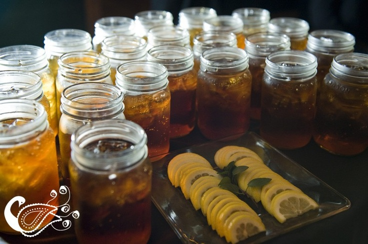 Southern style charm - serve refreshing sweet tea in mason jars accompanied with lemon and mint    Gorgeous photo by Swank Photo Studio | http://brds.vu/xYzYNu via @BridesView #wedding #photography