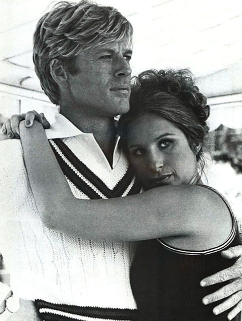 The way we were.   Robert Redford and Barbra Streisand. A movie I love.Redford is the handsomest  leading man ever.