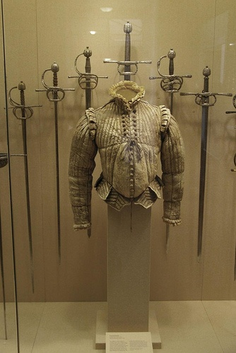 Metropolitan Museum:   Fencing doublet and swords  Fencing Doublet: Western Europe, ~1580.  Swords, left-to-right:  -Rapier: Possibly Italy, 1610-20.  -Rapier: Germany, 1610-20.  -Rapier: Northern Europe (probably Germany), blade dated 1620.  -Broadsword: Northern Europe (possibly Switzerland), early 17th century.  -Rapier: Probably French, 1610-20.  -Rapier: Probably Germany, early 17th century.    Sword blades are probably from Toledo, Spain, or Solingen, Germany.