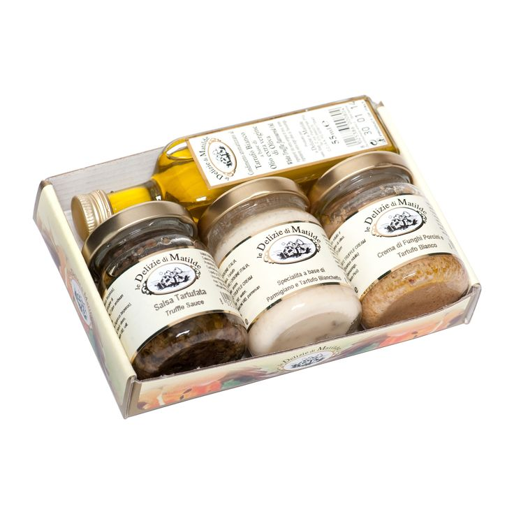 Am ales pentru voi trei specialitati cu trufa alba - uleiul de masline, crema de parmezan si crema de hribi cu trufe albe - alaturi de clasicul sos cu trufe. Pofta buna!