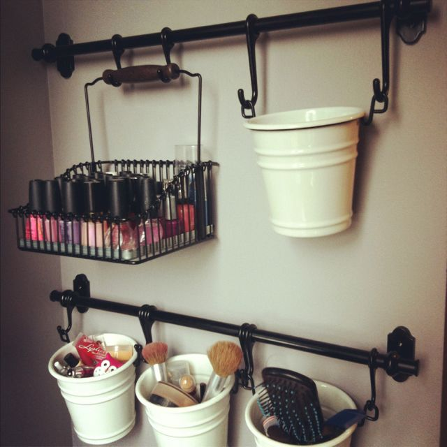 organization within my vanity using ikea rods and buckets found in their kitchen section, super easy!