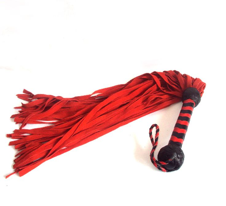 A soft suede flogger, with plaited red and black leather handle. Either as plain red or a combination of red and black suede leather tails. Perfect for both beginner and advanced players. Available at www.differentstrokes.co.za.